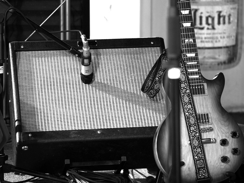 An image of a microphone recording a guitar amp