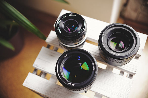 A collection of photo camera lenses on a table