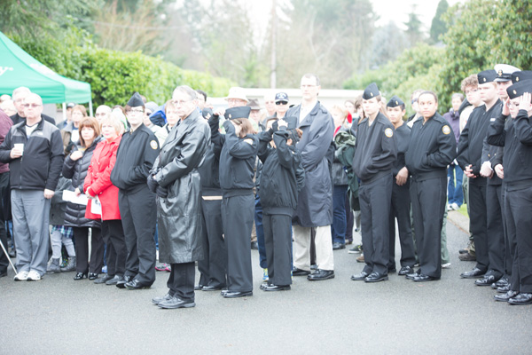 Image of people at a funeral over-exposed