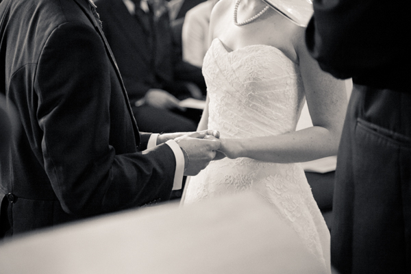 Bride and groom holding hands during vows