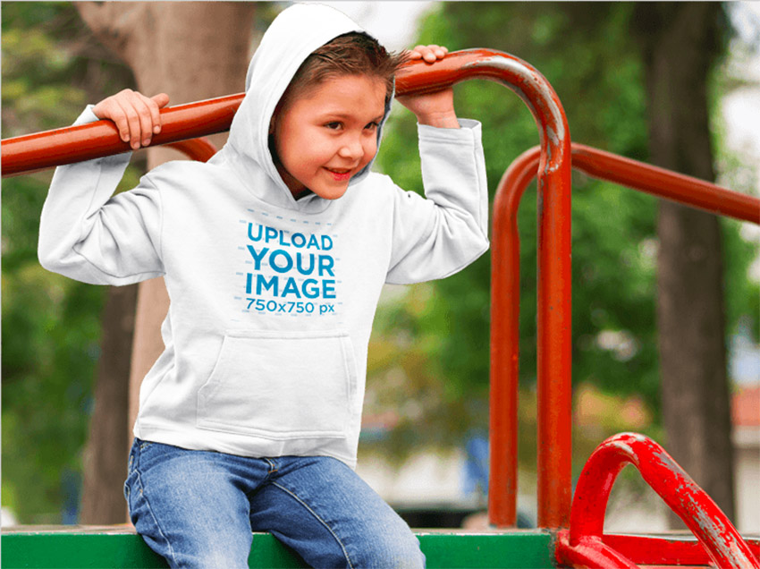Little Boy Wearing a Hoodie at a Park Mockup