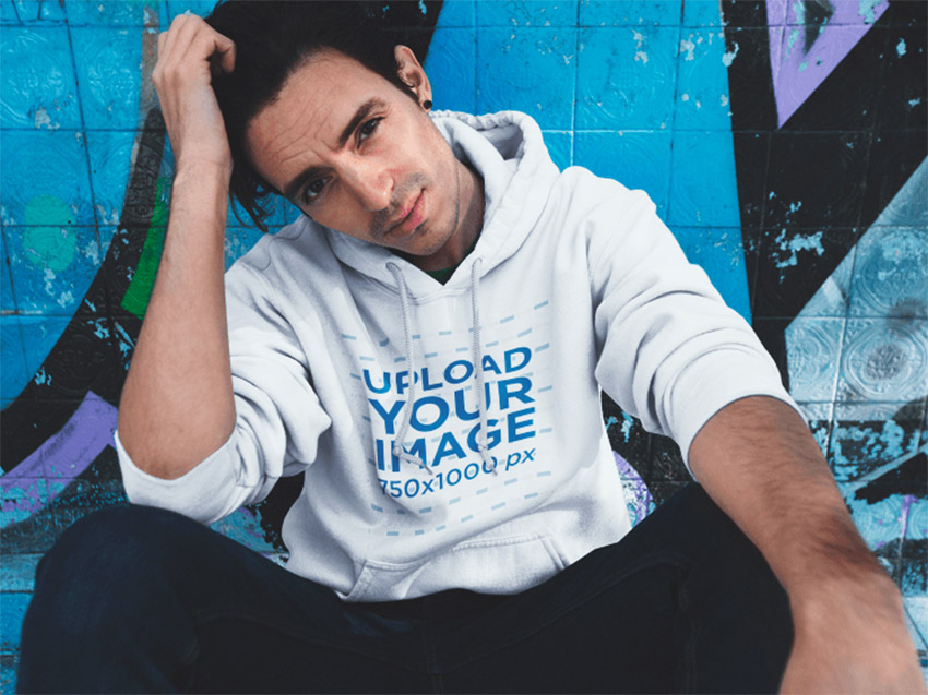 Pullover Hoodie Mockup Template of a Man Sitting at a Skate Park
