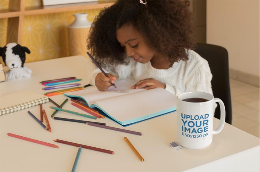 Mug Mockup of a Little Girl Coloring Her Book