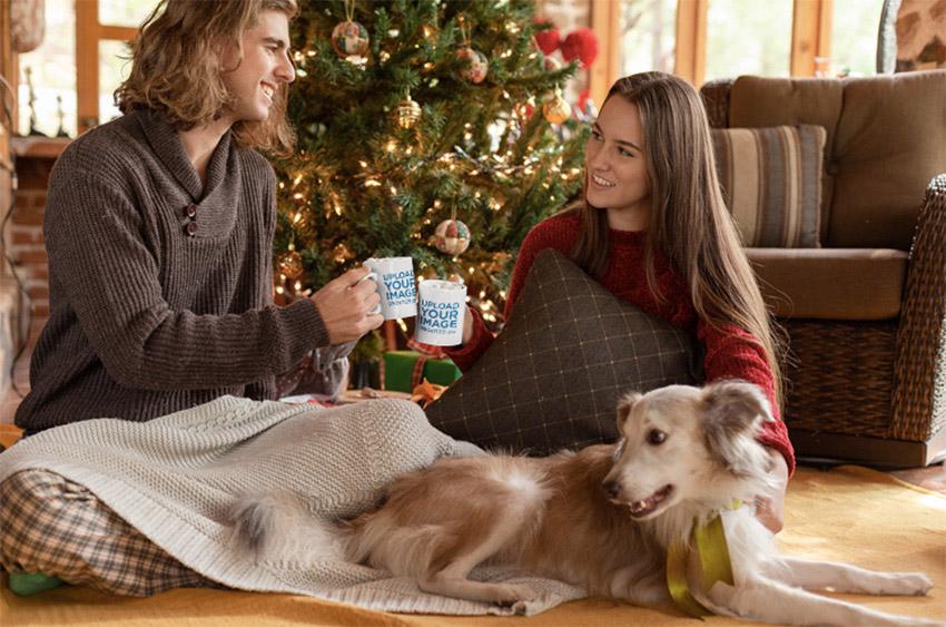 Mug Mockup of a Couple Drinking Hot Cocoa by a Christmas Tree