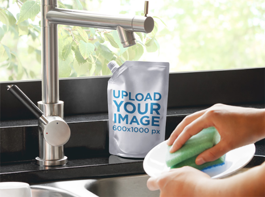 Packaging Mockup of a Liquid Soap Bag Next to a Kitchen Sink