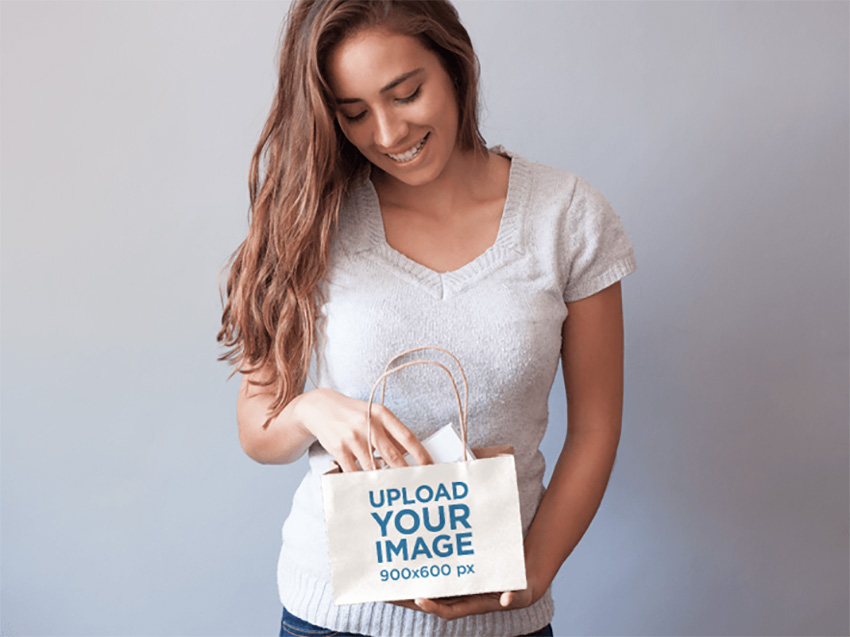 Packaging Mockup of a Young Woman Holding a Shopping Bag