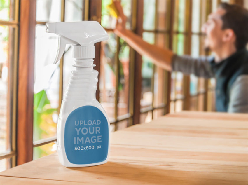 White Spray Bottle Mockup On Wooden Table With Man Cleaning
