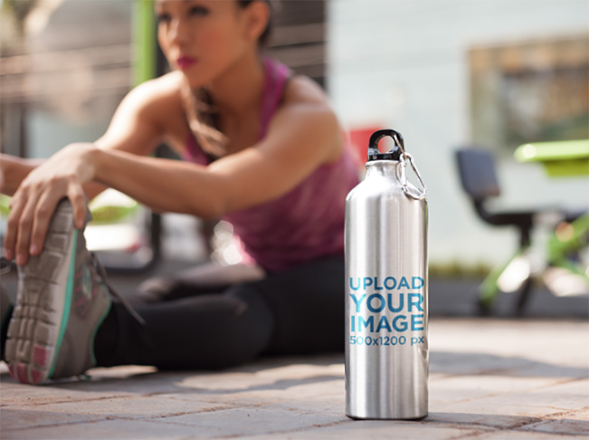 Woman Doing Exercises With an Aluminium Water Bottle Template Nearby