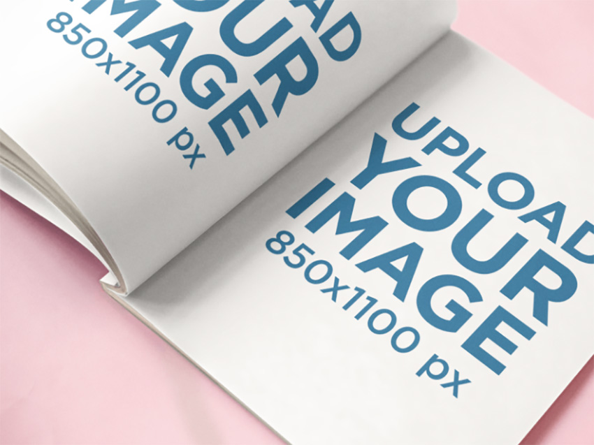 Open Magazine Lying on a Pink Surface Mockup