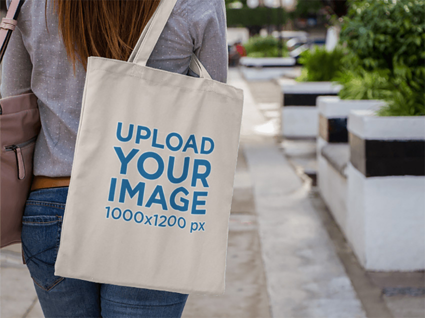 Canvas Tote Bag Mockup Over a Womans Shoulder