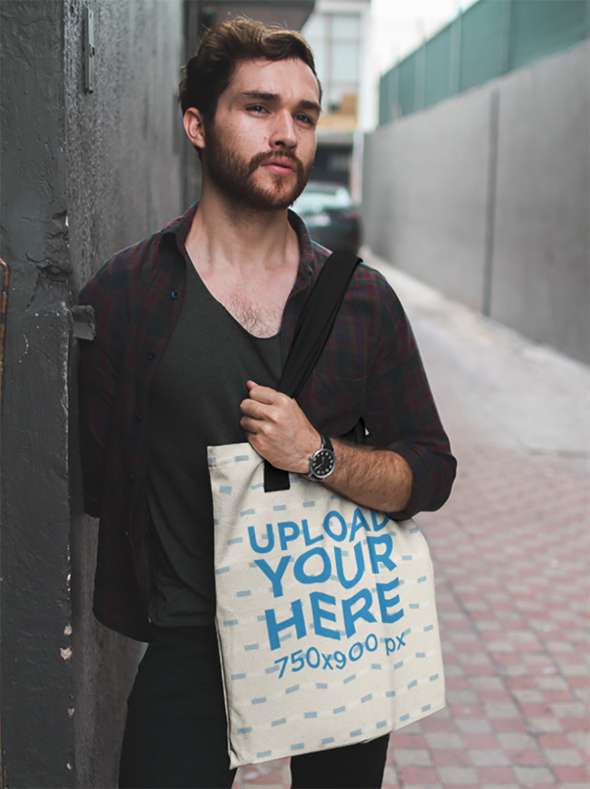 Dude Standing in an Alley While Carrying a Tote Bag Mockup