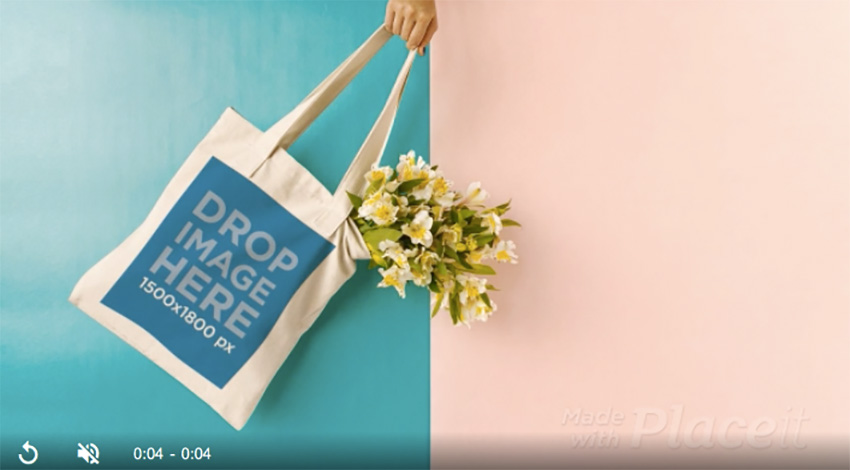 Hand Swinging a Tote Bag in Stop Motion Against Bicolored Background With Flowers