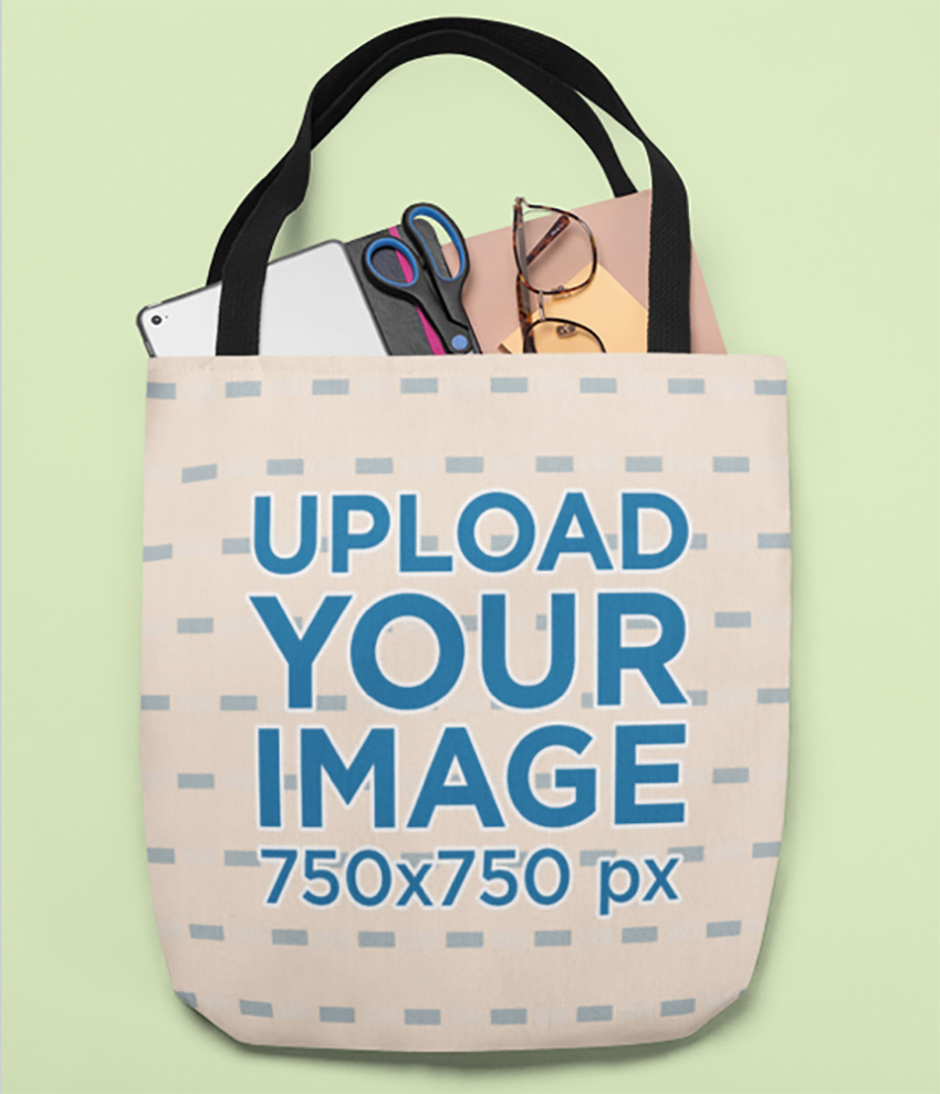 Mockup of a Tote Bag Full with Office Supplies