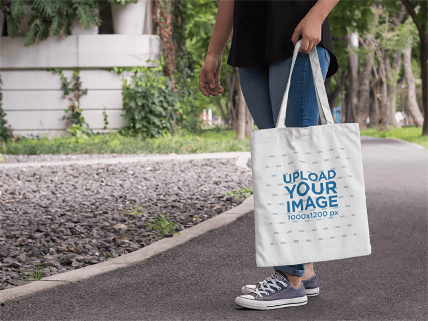 Tote Bag Mockup Featuring a Woman Near a Park