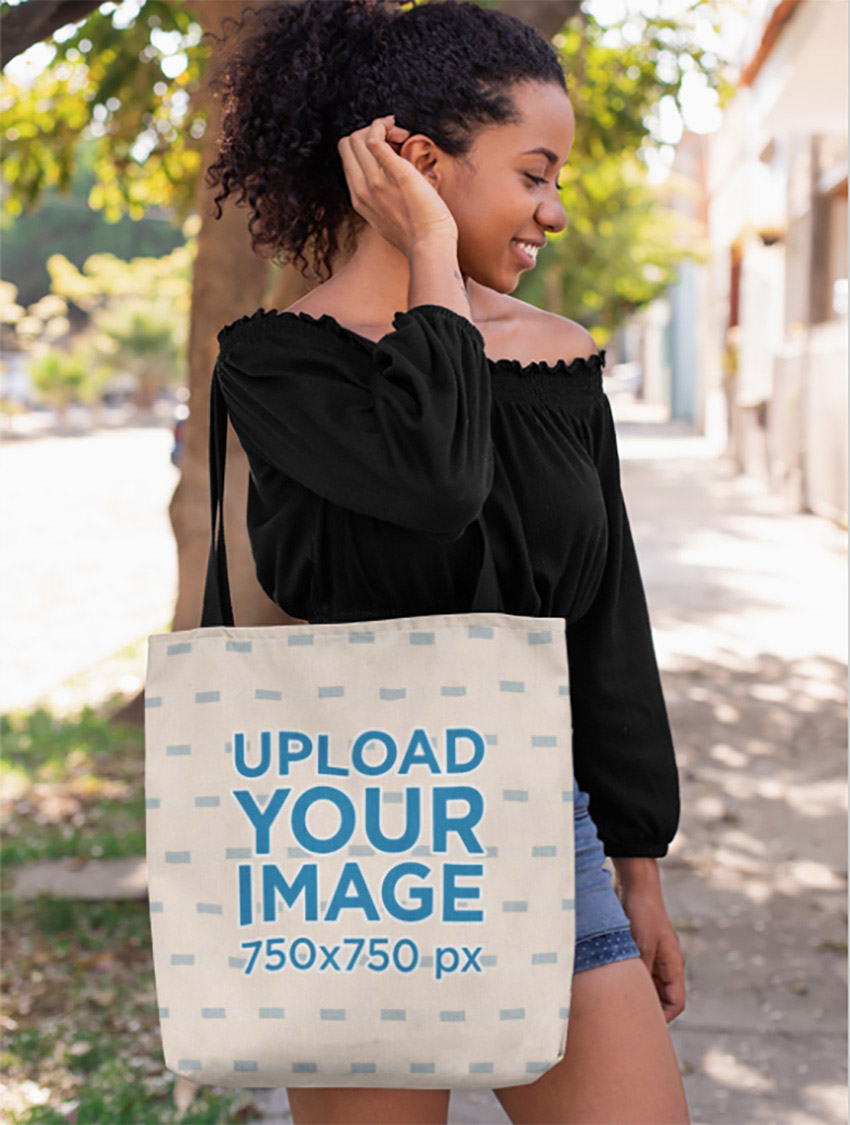 Tote Bag Mockup of a Woman Fixing Her Hair on a Street