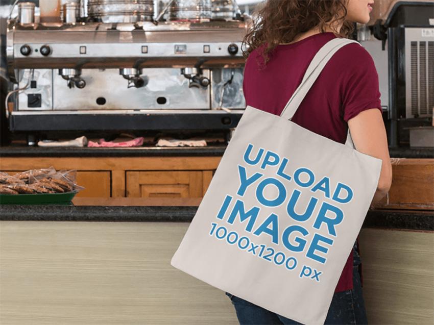 Tote Bag Mockup of a Woman at a Coffee Shop