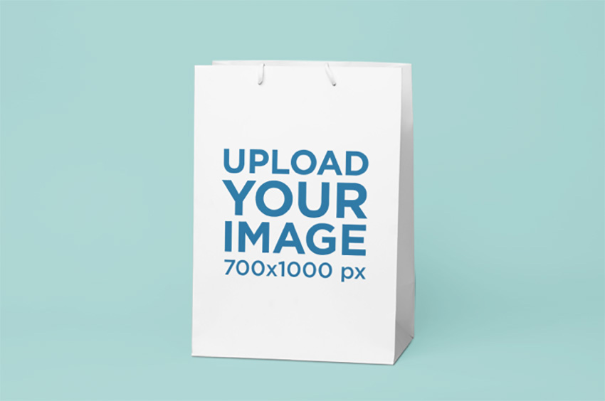 Gift Bag Mockup Featuring a Solid Background