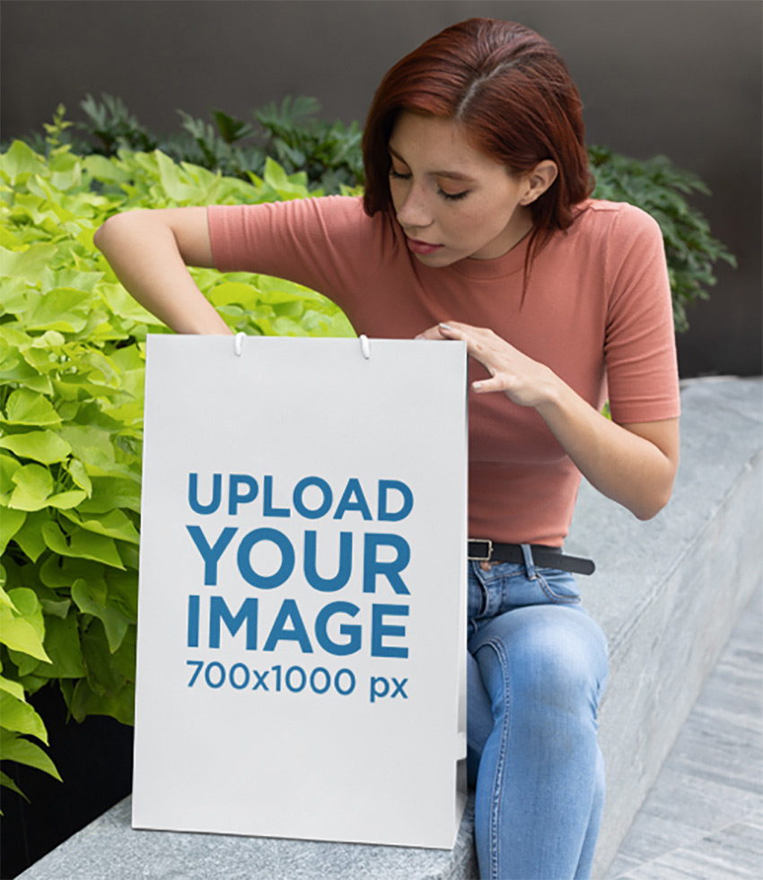 Mockup Featuring a Young Woman Looking Into a Large Gift Bag