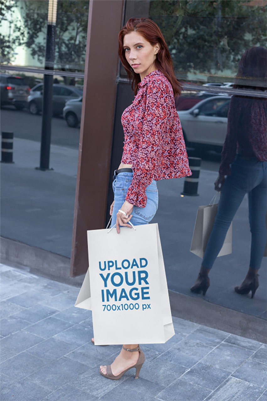 Mockup of a Tall Woman Walking with Her Large Gift Bag