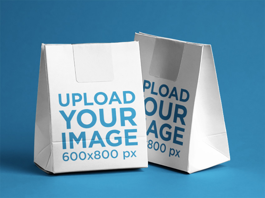 Paper Bag Mockup Featuring Two Paper Bags Over a Flat Surface