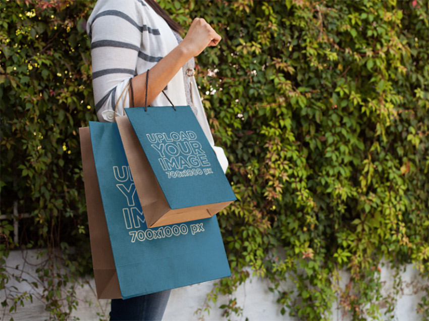 Paper Bag Mockup of a Woman Carrying Two Shopping Bags