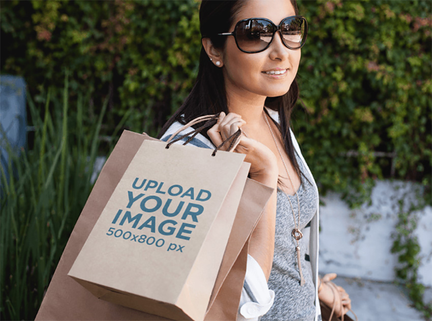 Paper Bag Mockup of a Woman Carrying a Set of Shopping Bags