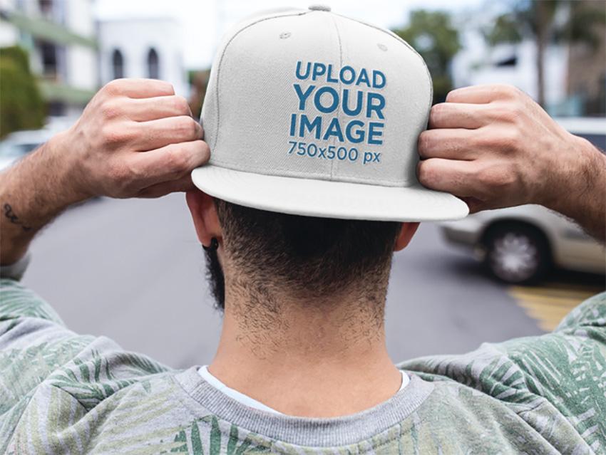 Backwards Snapback Hat Mockup of a Trendy Guy
