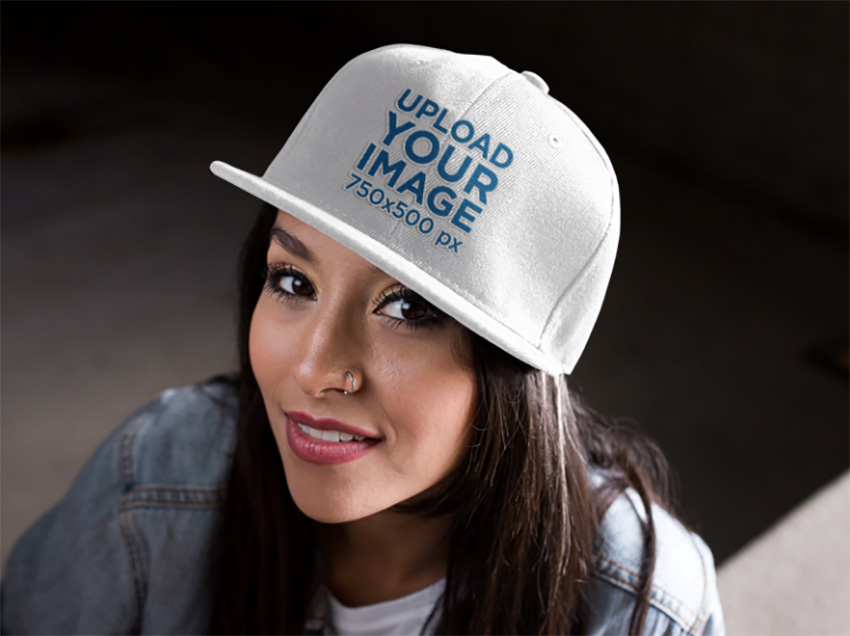 Snapback Mockup Featuring a Young Hispanic Girl Smiling