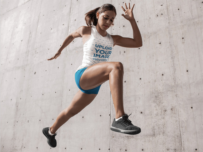 Track and Field Uniforms - Runner Woman Jumping Against Concrete Wall