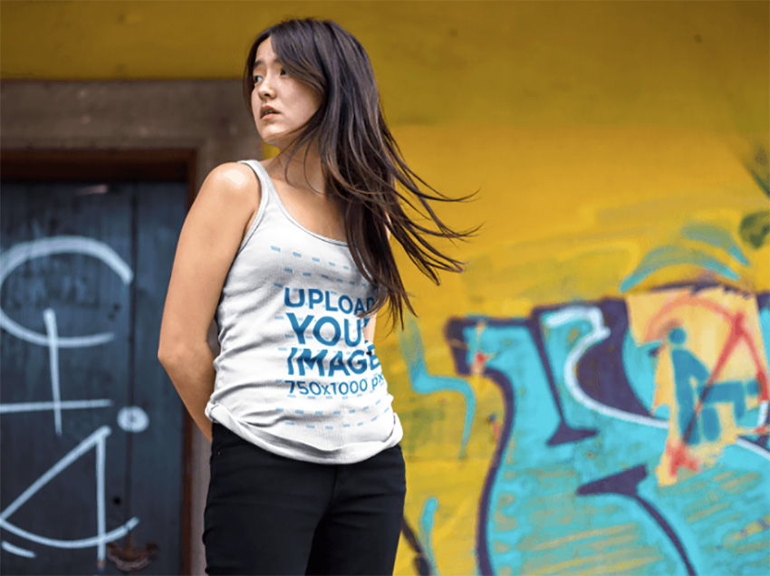 Tank Top Mockup Featuring a Pretty Asian Woman Near Urban Art