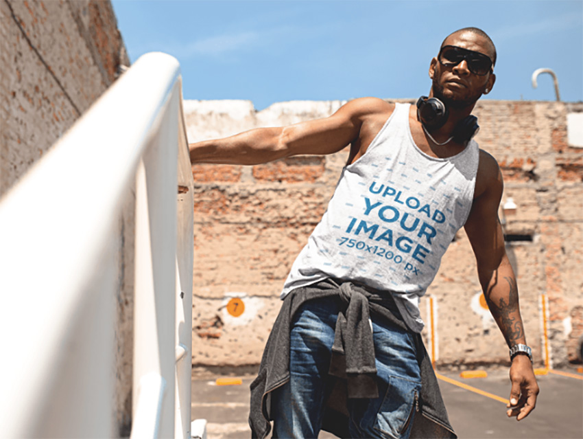 Tank Top Mockup of a Black Man Wearing Sunglasses in a City Building