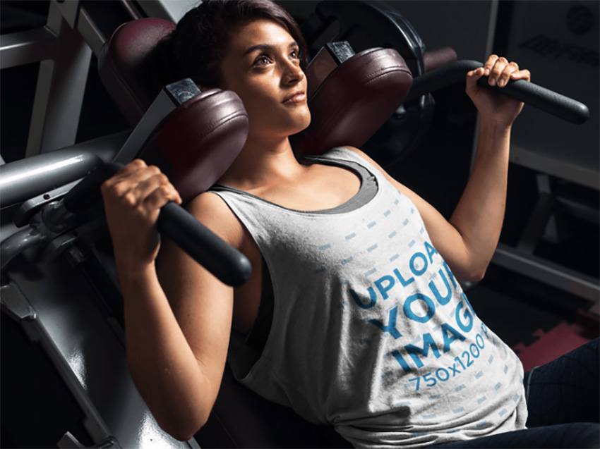 Tank Top Mockup of a Young Woman Exercising at the Gym
