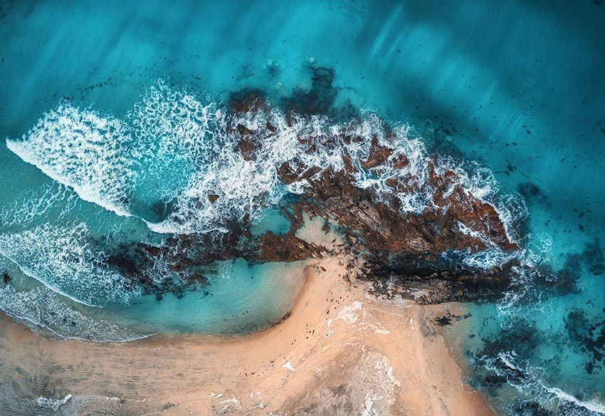 Image of aerial view of waves rocks and transparent sea PYQ8E3R%20copy