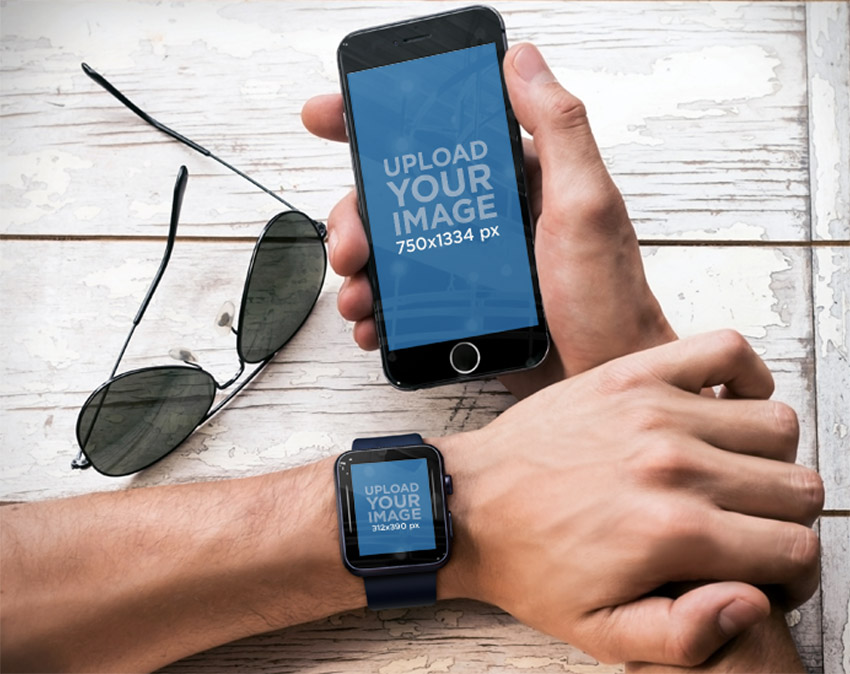 Top Shot of Man Holding iPhone 6 and Wearing a Black Apple Watch