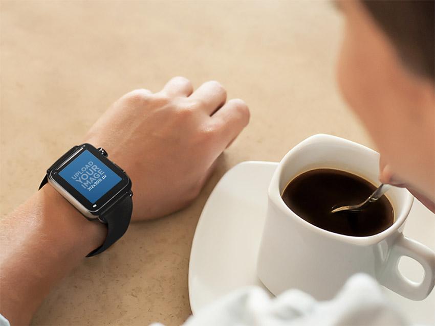 Young Lady on Coffee Break Wearing a Black Apple Watch
