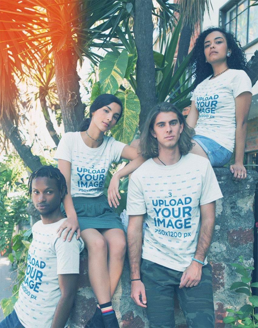 Group Wearing T-Shirts Mockup Near Plants