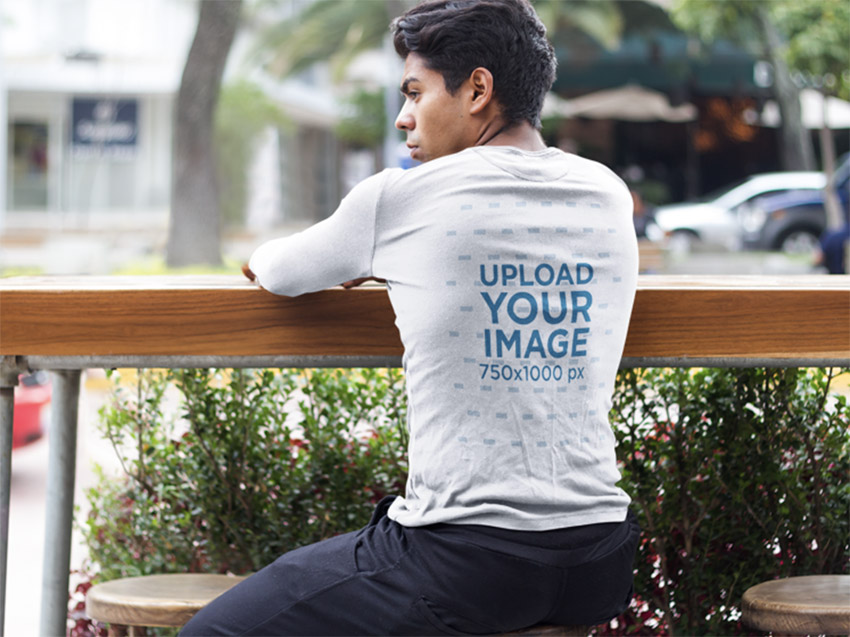 Young Man Sitting on a Stool Long Sleeve Tee Mockup