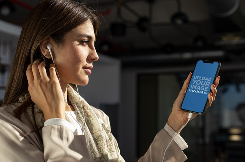 iPhone 11 Pro Max Mockup Featuring a Young Woman Listening to a Podcast