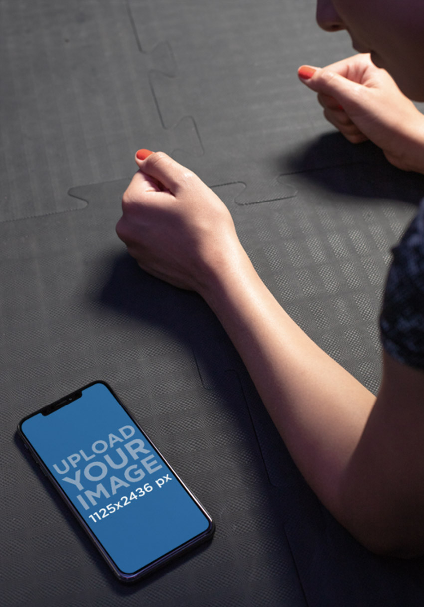 iPhone 11 Pro Mockup Featuring a Woman Doing a Plank