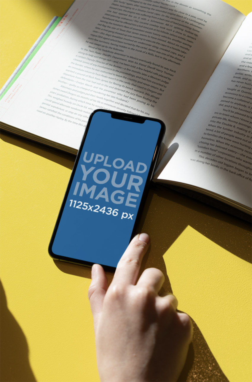 iPhone 11 Pro Mockup over an Open Book