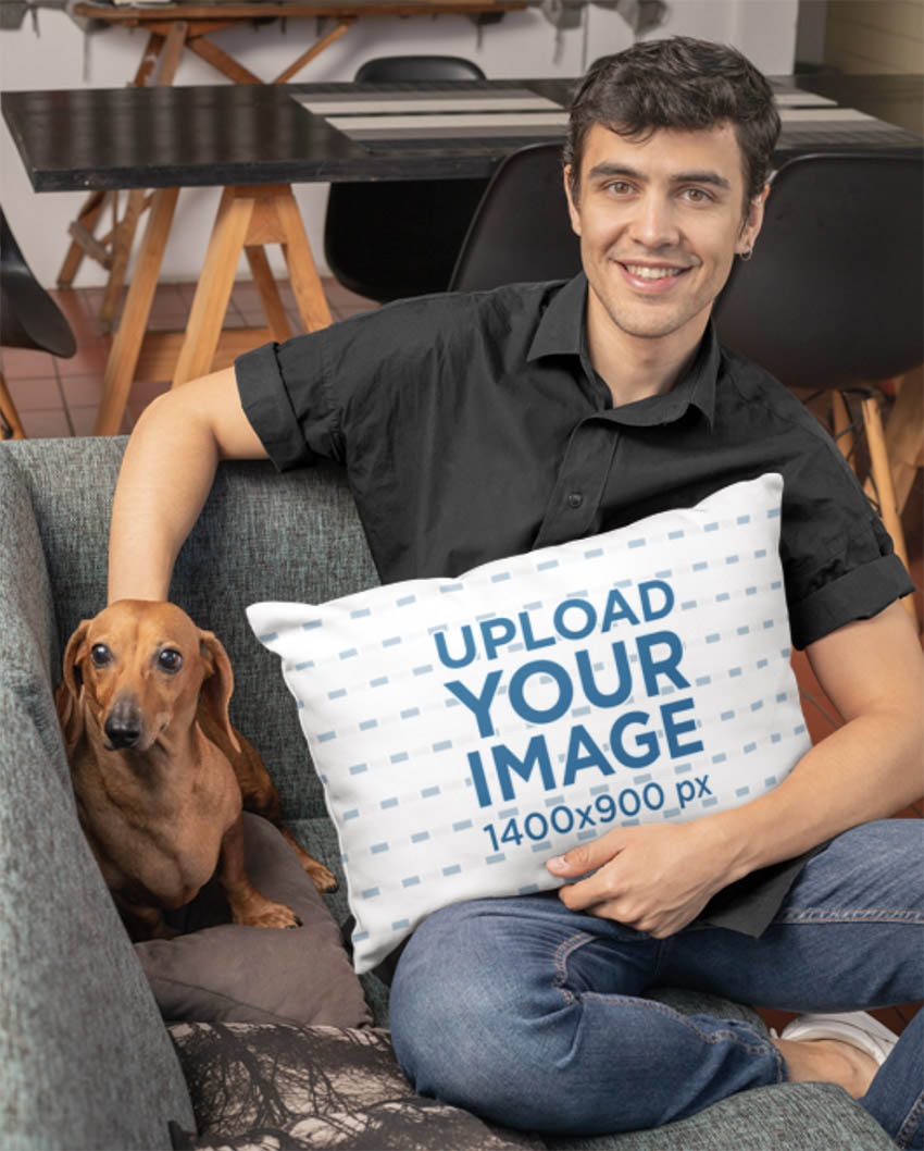 Mockup of a Man Holding a Pillow While Petting a Dog