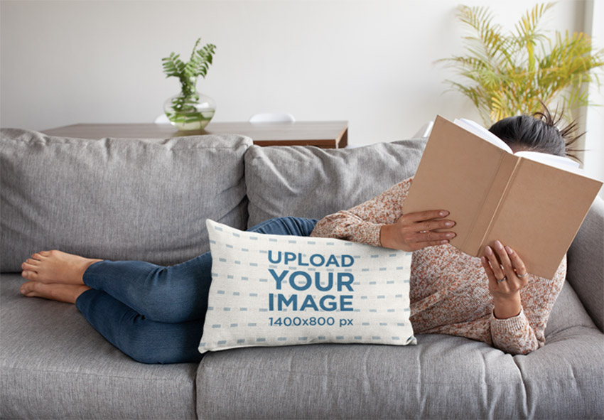 Pillow Mockup of a Woman Lying on a Sofa with a Book on Her Face
