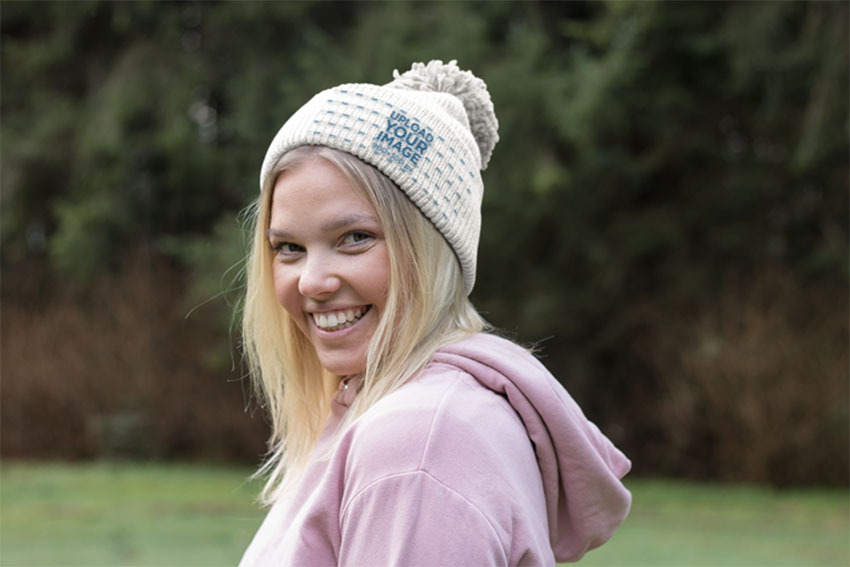 Beanie Mockup of a Smiling Woman at the Forest