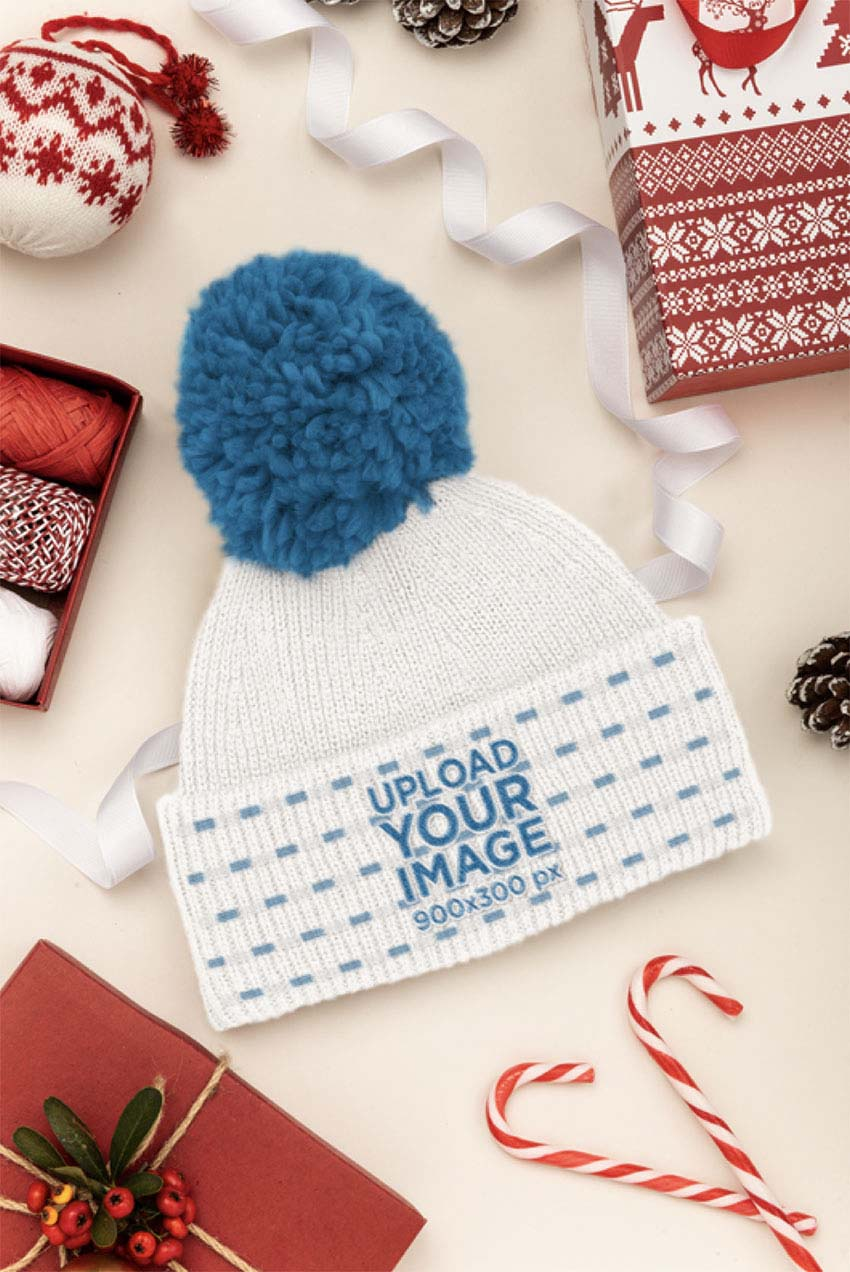 Mockup of a Beanie Surrounded by Christmas Decorations