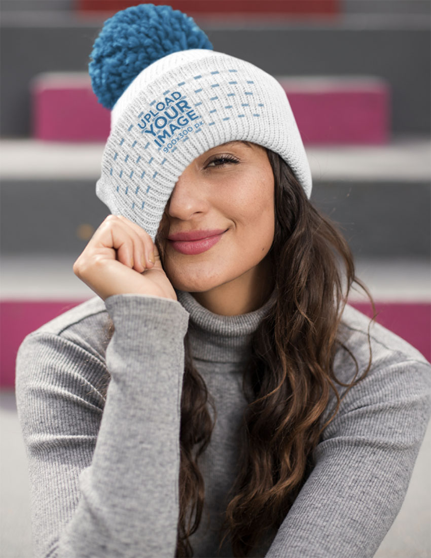 Mockup of a Beautiful Brunette Woman Wearing a Pom Pom Beanie
