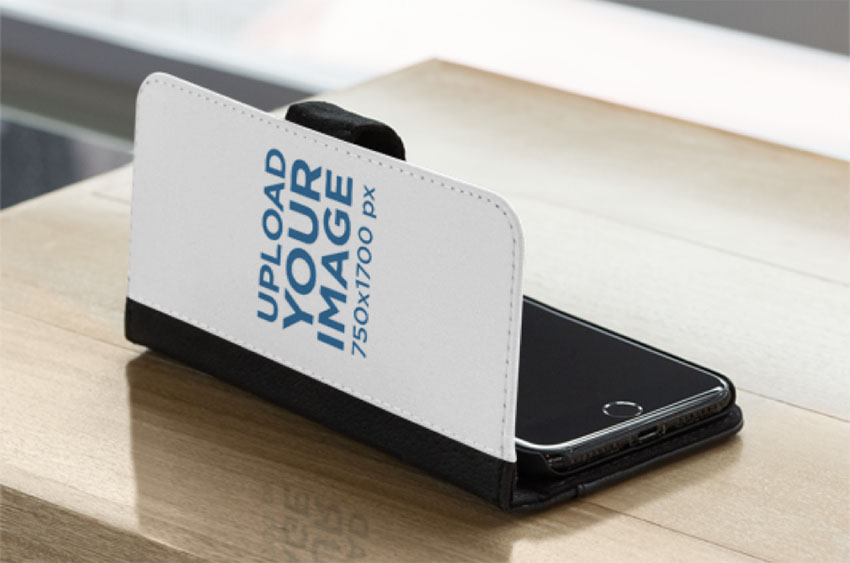 Mockup of a Wallet Case for iPhone 11 Lying on a Table