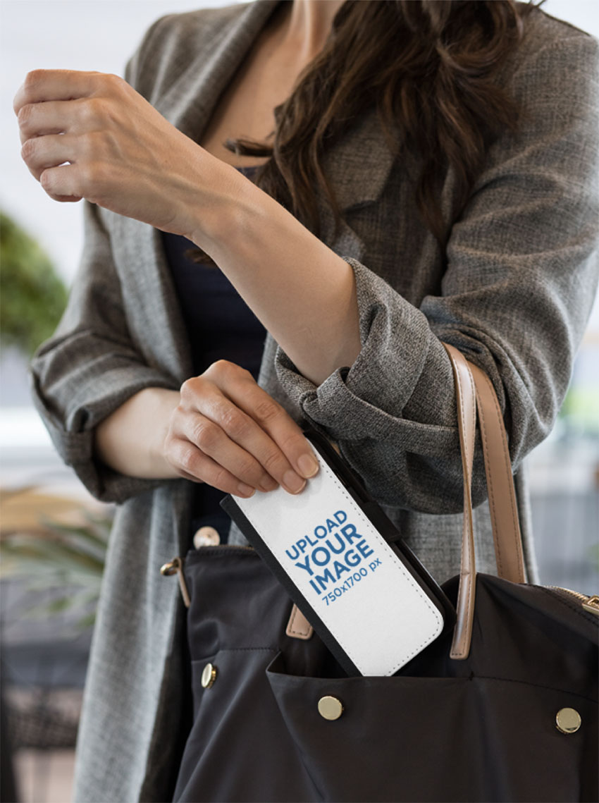 Mockup of a Woman Putting a Wallet Case for iPhone 8 Plus in Her Bag