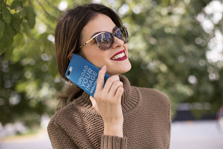 Mockup of an iPhone Case and a Woman Wearing a Brown Sweater