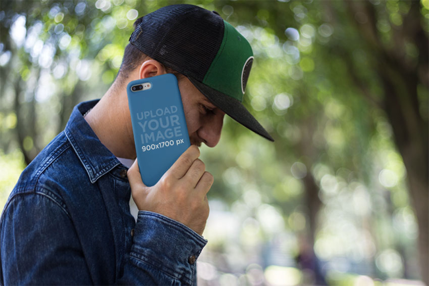 Phone Case Mockup of a Man Making a Call at a Park