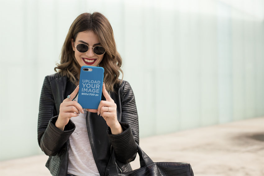 iPhone Case Mockup Featuring a Woman Smiling at Her Phone